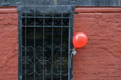 Red balloon at the entrance Royalty Free Stock Image