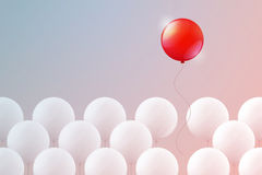 Red balloon flying free upward Stock Images