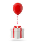 Red balloon with gift box on white background Royalty Free Stock Image