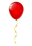 Red balloon. With golden ribbon Royalty Free Stock Photo