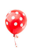 Red balloon with polka dots. On a white background royalty free stock image