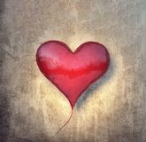 Red balloon in shape of a heart with grungy vintage wall Valentines background stock image