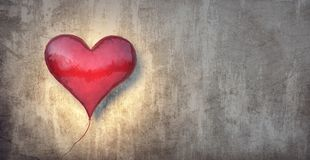 Red balloon in shape of a heart with grungy vintage wall Valentines background stock photography