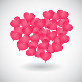 A red balloon in the shape of heart. On white Royalty Free Stock Photo