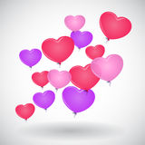A red balloon in the shape of heart. On white Royalty Free Stock Images