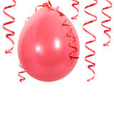 Red balloon and streamers Stock Image