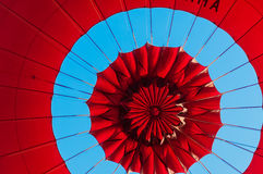 Red Balloon. Top of a Red Balloon under a blue sky Royalty Free Stock Photo