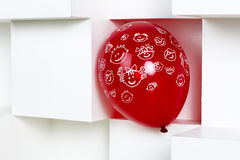 Red balloon on a white background. Royalty Free Stock Image