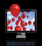 Red balloons in a 3D tv screen. Isolated on black whith clipping path Royalty Free Stock Images