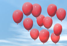 Red balloons. A bunch of red balloons against a blue sky Stock Photo