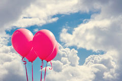 Red balloons on blue sky Royalty Free Stock Photography