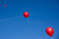 Red balloons on blue sky Stock Images