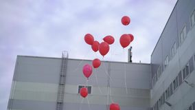 Red balloons flying