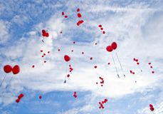 Red balloons flying to the sky. With best wishes Stock Image