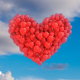 Red balloons forming a heart on sky Royalty Free Stock Images