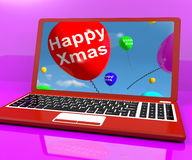 Red Balloons With Happy Xmas On Computer For Online Greetings. Red Balloons With Happy Xmas On Computer Show Online Greetings Stock Photography