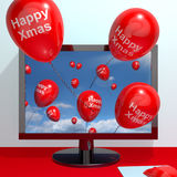 Red Balloons With Happy Xmas From Computer Screen For Online Gre. Eting Stock Photo