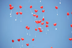 Red balloons. With the messages in the blue sky Stock Photos