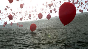 Red balloons over the ocean Stock Photography