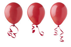 Red Balloons with Ribbons. Three red party balloons, tied with curly ribbons, isolated on a white background Royalty Free Stock Photos