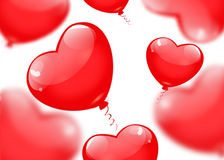 Red balloons in the shape of a heart isolated on white backgroun Stock Photos