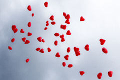 Red balloons. Red balloons in the shape of hearts on a background of the sky Royalty Free Stock Photos