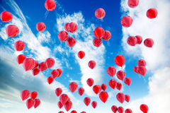 Red balloons and sky. Red balloons floating over the blue sky Stock Photography