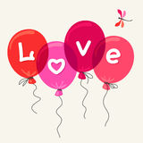 Red balloons with text Love. Stock Photos