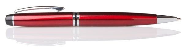 Red ballpoint pen. On white background Royalty Free Stock Photo