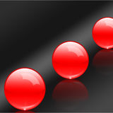 Red balls. An illustration of 3D  red glass balls on the dark grey background Stock Photos