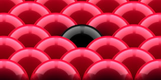 Red balls and the black one Stock Photo