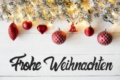 Red Balls, Calligraphy Frohe Weihnachten Means Merry Christmas. Christmas Banner With German Calligraphy Frohe Weihnachten Means Merry Christmas. Fir tree Branch stock photos