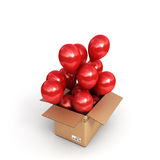 Red balls in a cardboard box for deliveries  on white ba Royalty Free Stock Photos