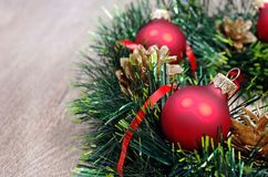 Red balls and christmas wreath on a wooden table. close up. copy spaces. stock image