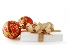 Red balls and gift Stock Photography