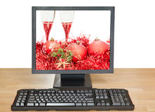 Red balls and glasses on screen of desktop PC Royalty Free Stock Images