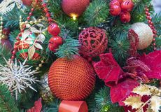 Red balls and golden snowflakes on the Christmas tree.  stock images