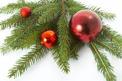 Red balls hanging from christmas tree Royalty Free Stock Photography