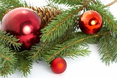 Red balls hanging from christmas tree Royalty Free Stock Images
