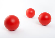 Red balls on white background Stock Photography