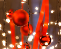 Red balls white small lightbulbs for christmas on the ceiling Stock Image