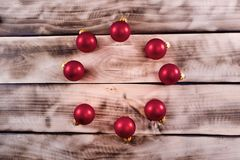 Red balls on a wooden background. Postcard Royalty Free Stock Photos