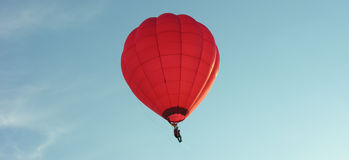 Red baloon. One-seater balloon in the sky Stock Photo