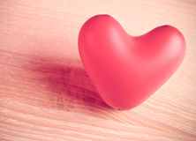 Red baloon heart. On wooden table, desatureted color Stock Image