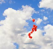 Red baloons in the sky. Picture of a red baloons in the sky royalty free stock images