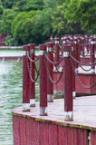 Red Baluster. Red wood baluster by a lake in nanning of China royalty free stock photography