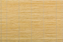 Red bamboo mat, wooden background Stock Image