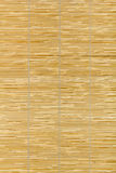 Red bamboo mat, wooden background Stock Images