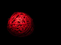 Red bamboo orb, illuminated over black Royalty Free Stock Images