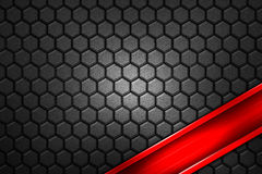 Red banner on gray carbon fiber hexagon. Royalty Free Stock Photo